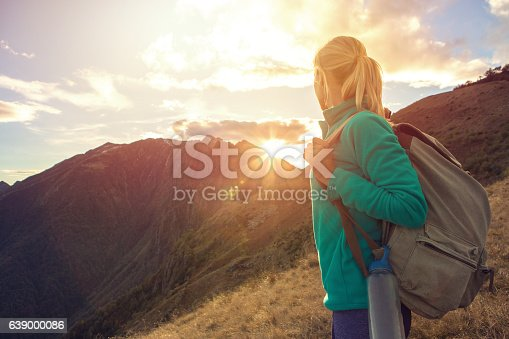 istock Young woman hiking in Autumn, Switzerland 639000086