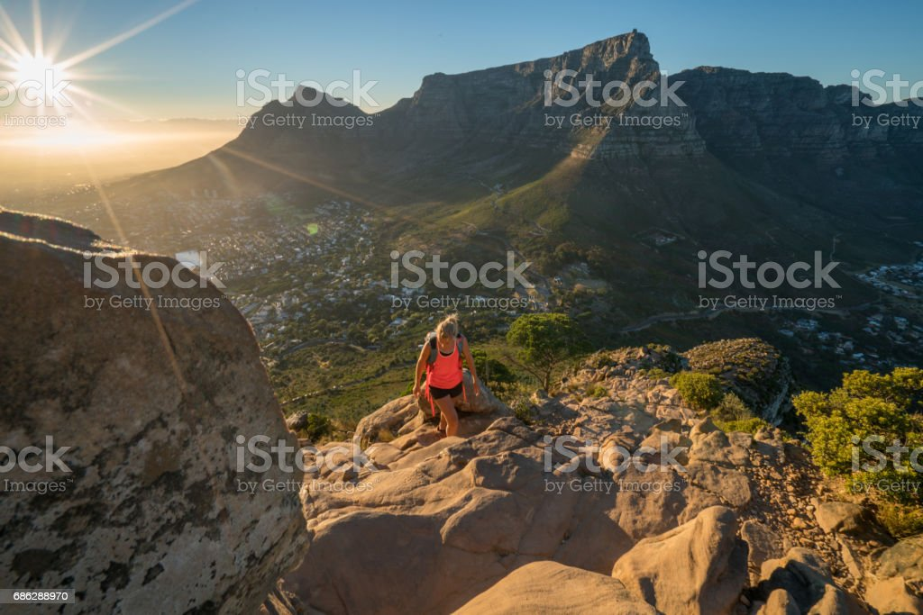 Young woman hiking in Cape Town at sunrise stock photo