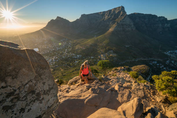 young woman hiking in cape town at sunrise - table mountain national park stock pictures, royalty-free photos & images