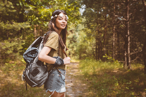 Young woman hiking in forest