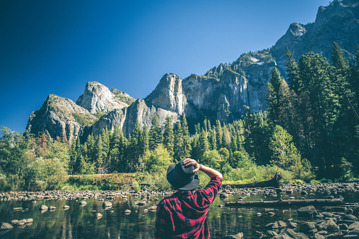 istock Young woman hiking in majestic landscape 618200912