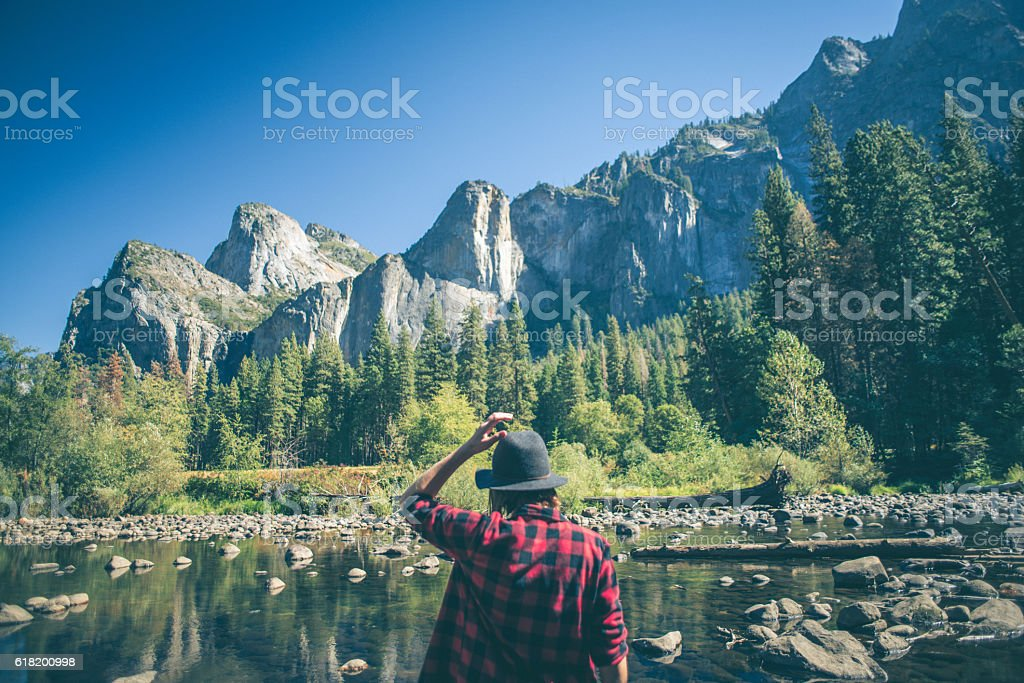 Young woman hiking in majestic landscape stock photo