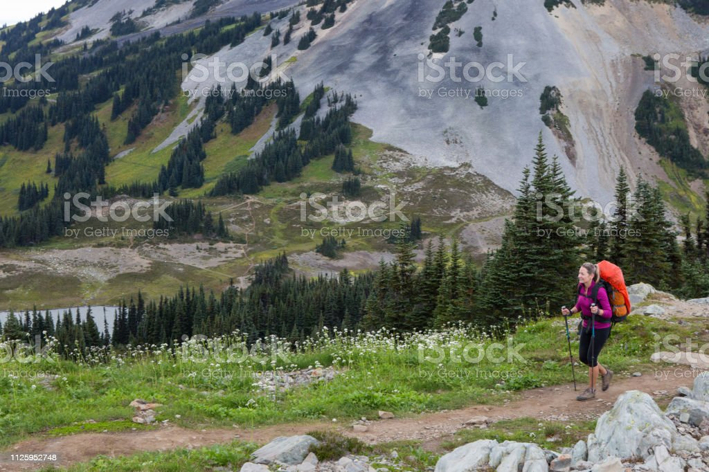 Young woman hiking in the mountains stock photo