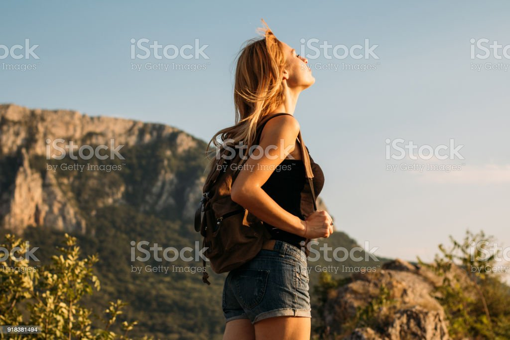 Young woman hiking on a lovely sunny day stock photo
