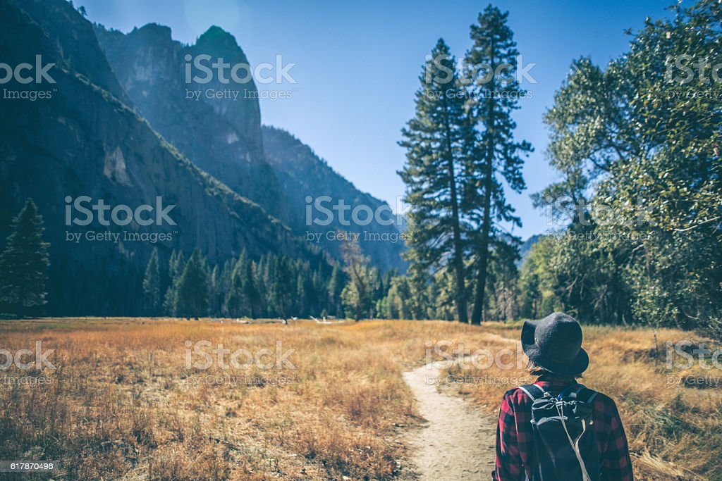 Young woman hiking on a trail stock photo