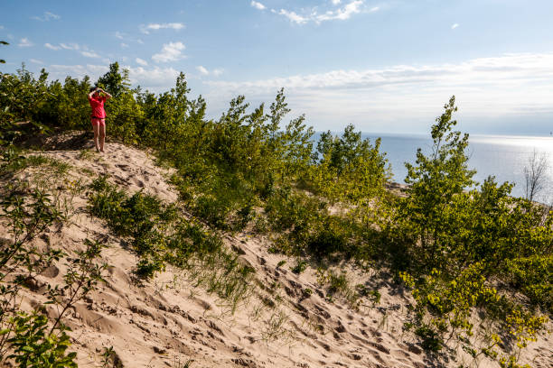 Young woman hiking on dunes stock photo