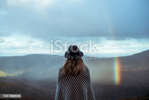 istock Young woman hiking through beautiful mountains. 1057668530
