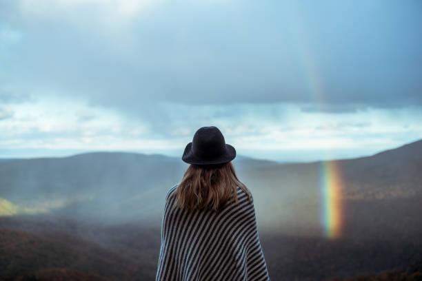 Young woman hiking through beautiful mountains. stock photo