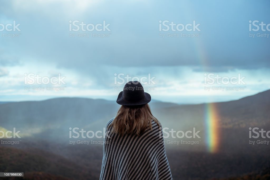 Young woman hiking through beautiful mountains. stock photo