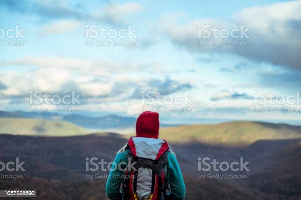 Young Woman Hiking Through Beautiful Mountains Stock Photo - Download Image Now