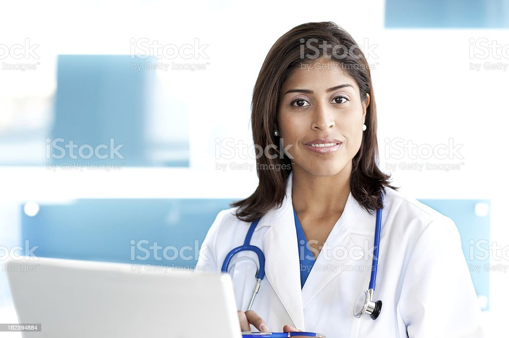 Young Woman Hispanic Doctor Nurse in Office royalty-free stock photo