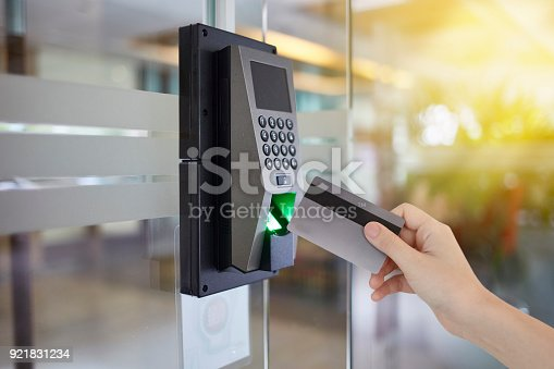 istock Young woman hold key card to access door office 921831234