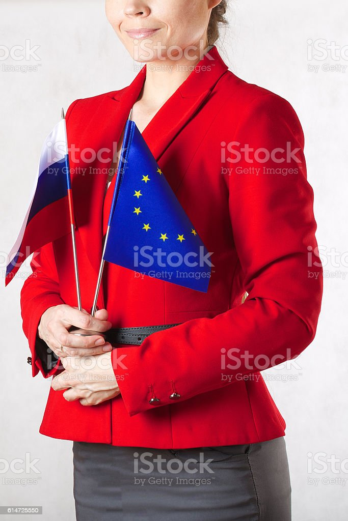 Young woman hold two flags of EU a stock photo