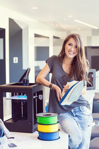 Young Woman Holding 3d Printout An Iron Stock Photo - Download Image Now