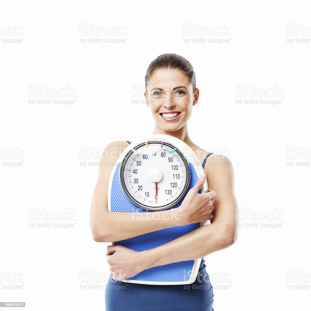 Young Woman Holding a Bathroom Scale - Isolated royalty-free stock photo