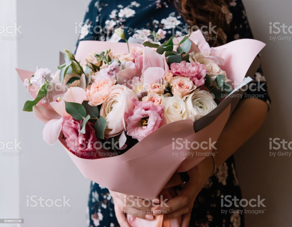 Young Woman Holding A Big Beautiful Blossoming Flower Bouquet On The