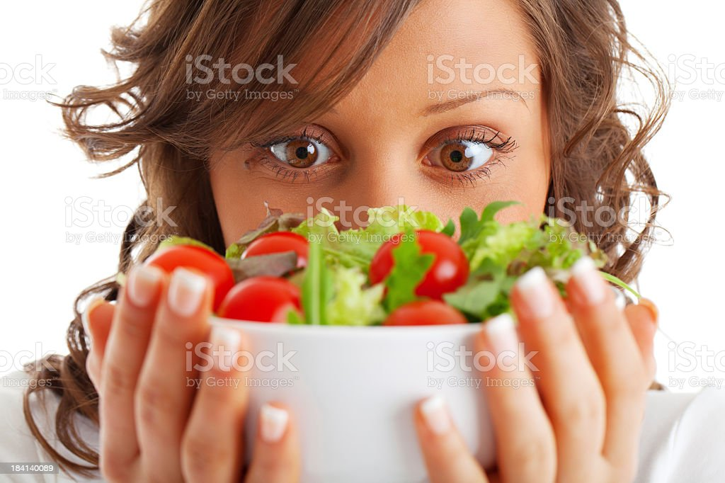 Young woman holding a bowl of salad in front of her royalty-free stock photo