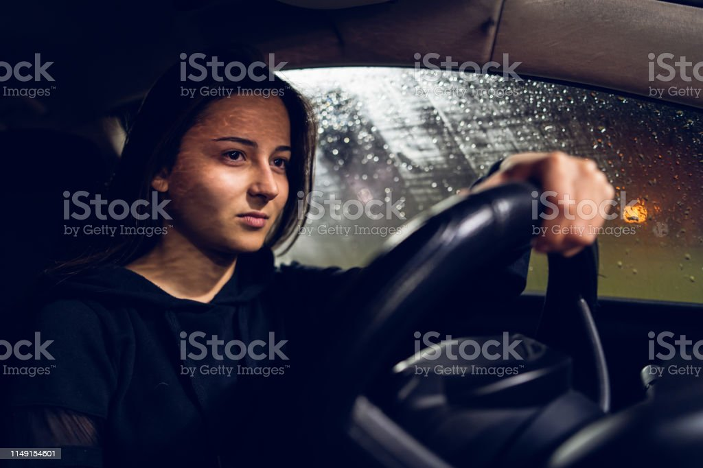 Young Woman Holding A Car Driving Wheel In A Rainy Night Rain Stock Photo Download Image Now Istock