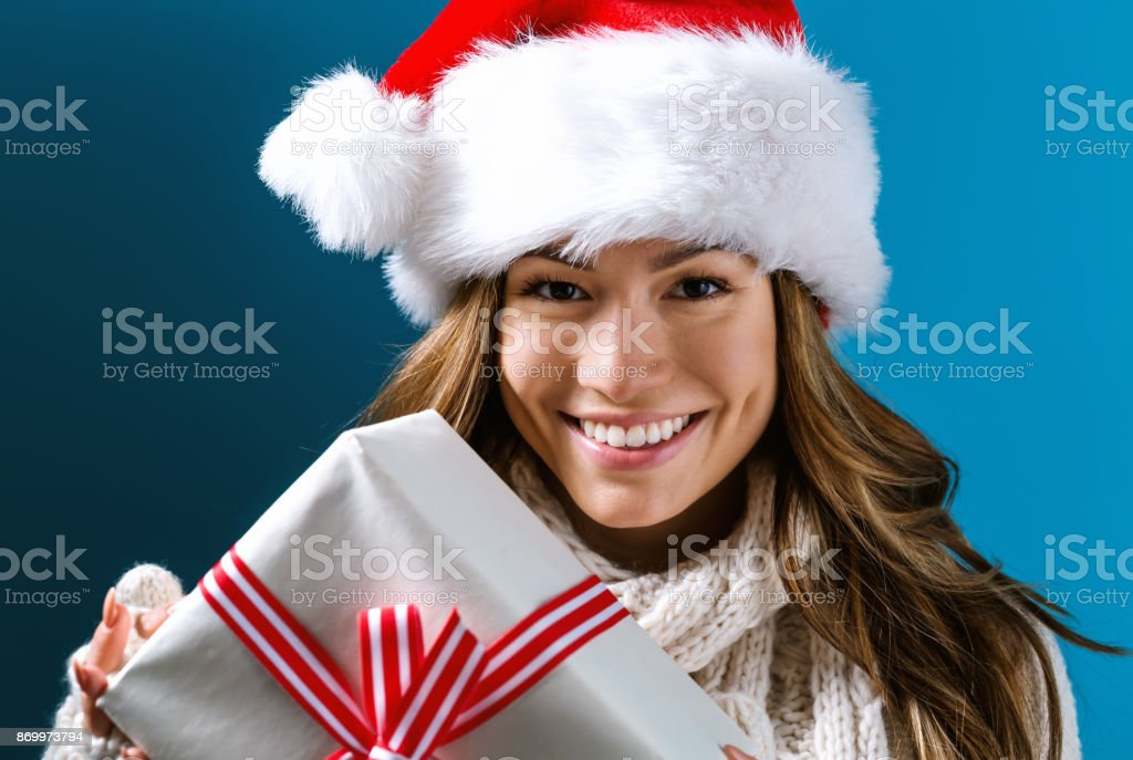 Young woman holding a Christmas gift stock photo