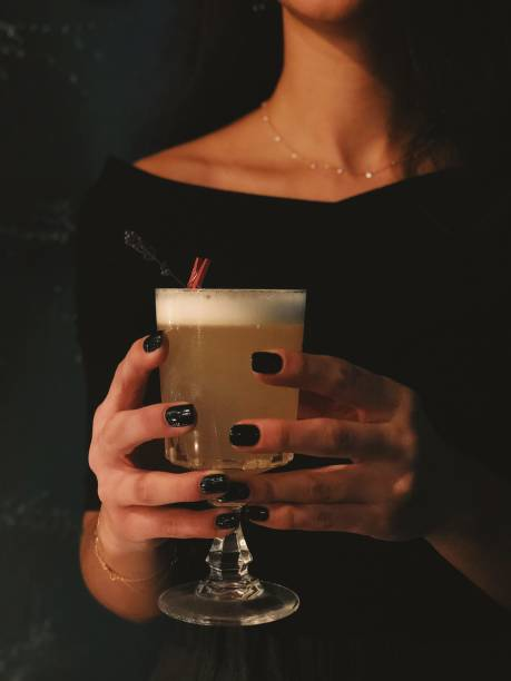 Young woman holding a cocktail glass stock photo