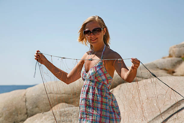 Young woman holding a fishing net stock photo