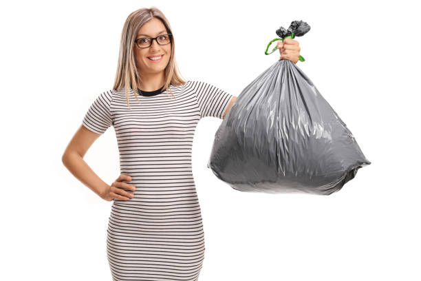 Young woman holding a garbage bag stock photo