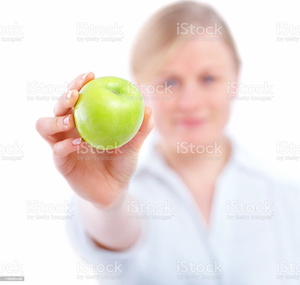 Young woman holding a green apple royalty-free stock photo