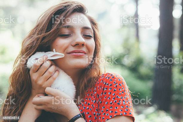 Young woman holding a little white bunny at nature picture id485904614?b=1&k=6&m=485904614&s=612x612&h=ohek xwqvnt7kggeffzfp5ciflckkelnbxtnd7mvfqs=