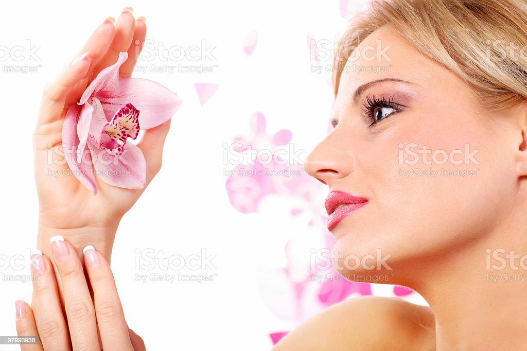 Young woman holding a lovely pink orchid. royalty-free stock photo