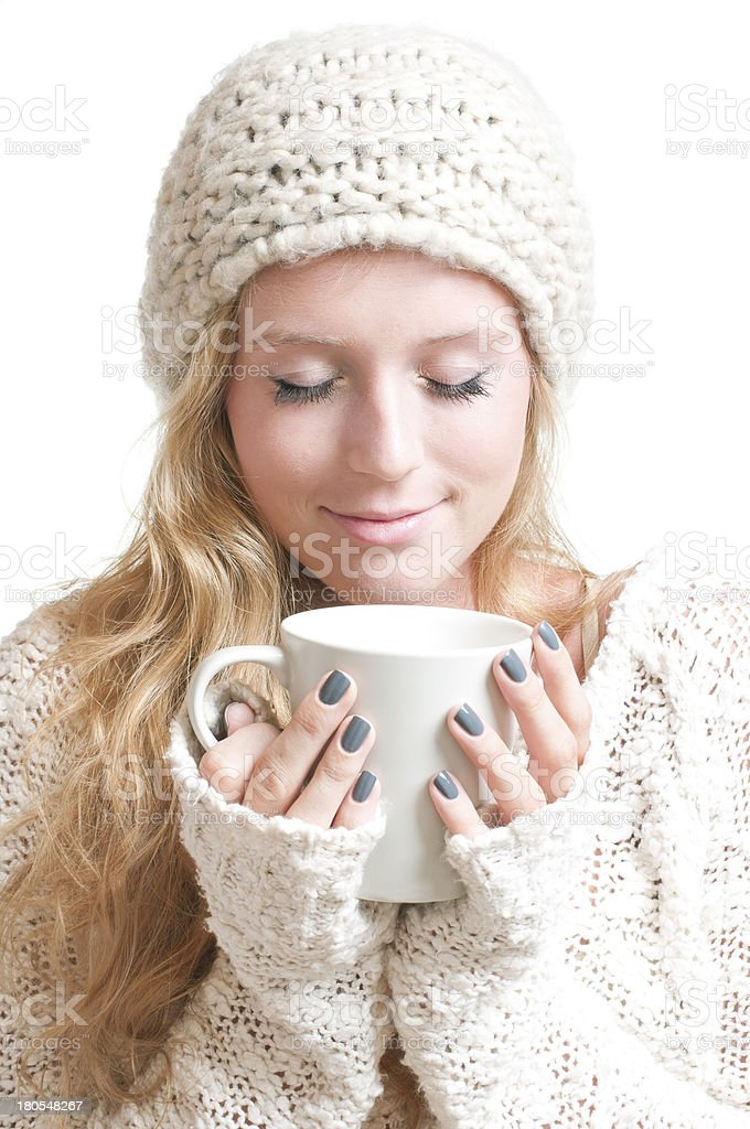 Young woman holding a mug eyes closed royalty-free stock photo