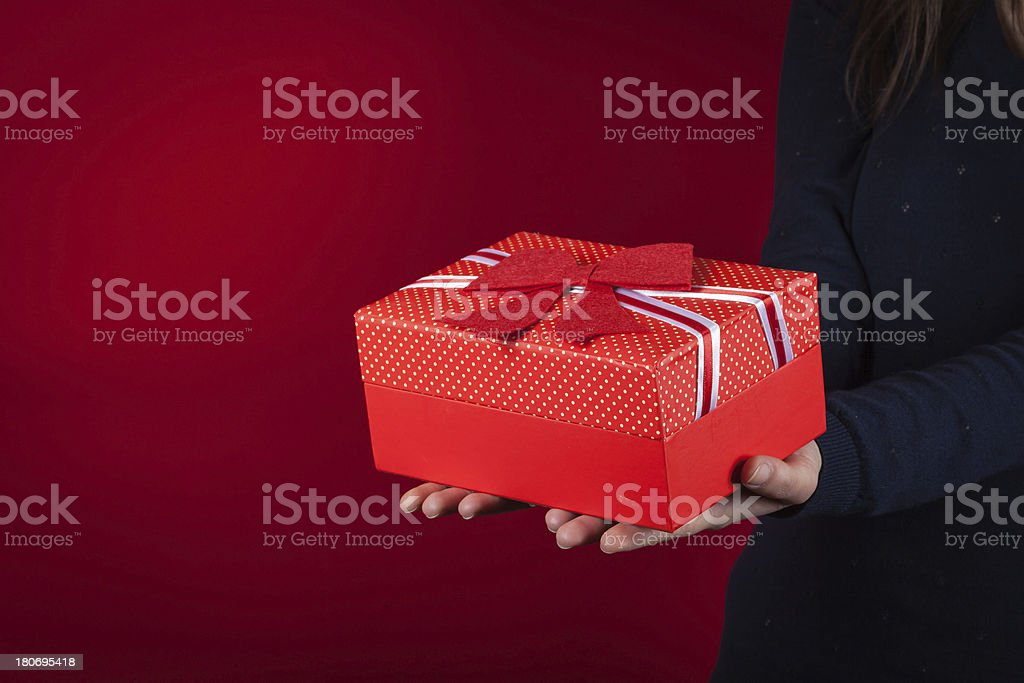 Young woman holding a present in her hands royalty-free stock photo