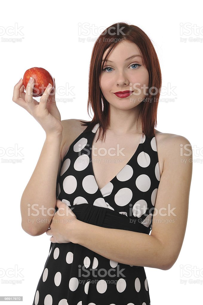Young woman holding a red apple royalty-free stock photo
