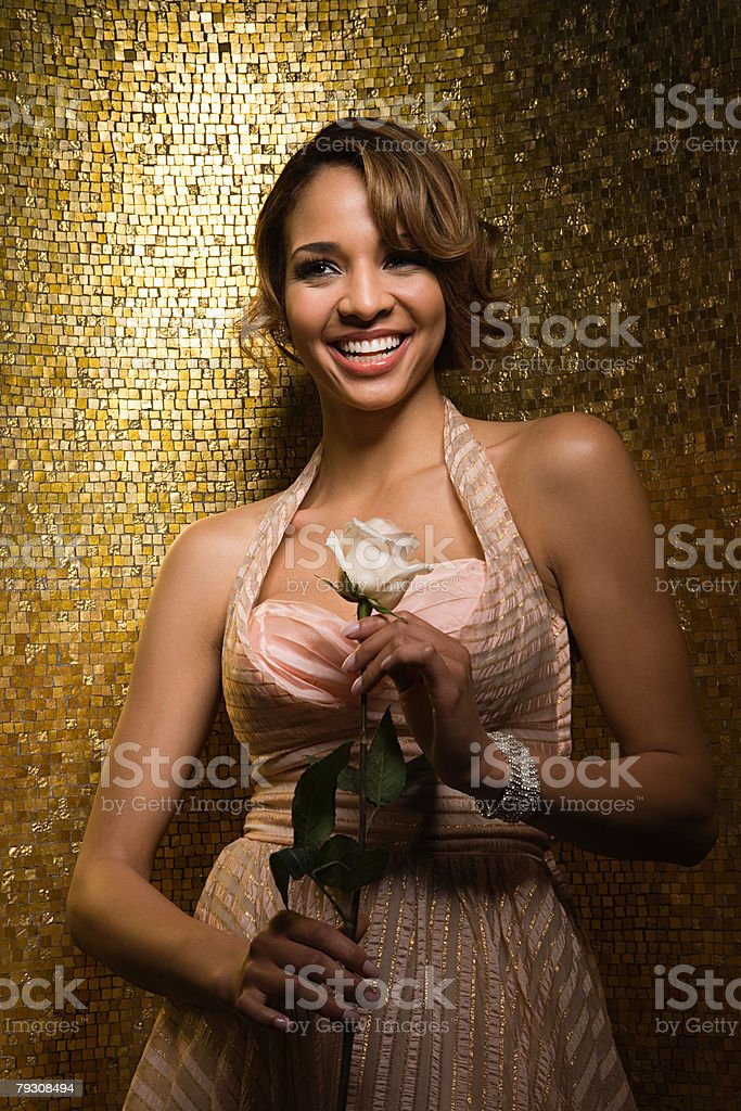 ローズを持つ若い女性の ロイヤリティフリーストックフォト