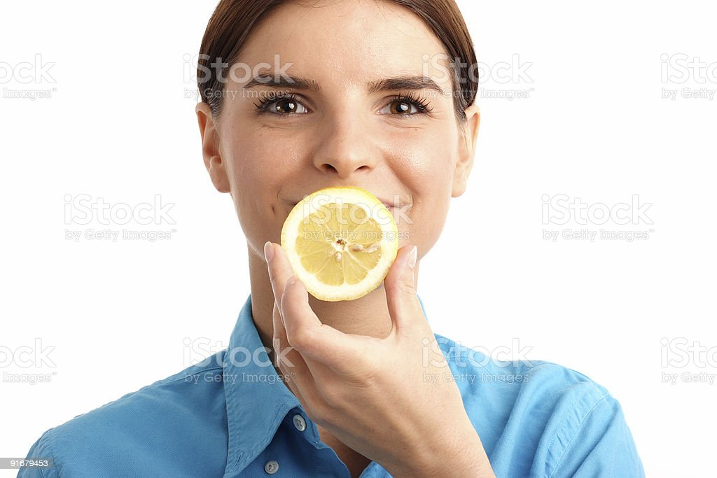Young woman holding a slice of lemon stock photo