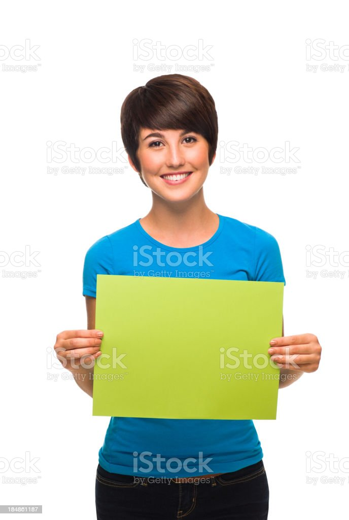 Young woman holding a small blank sign royalty-free stock photo