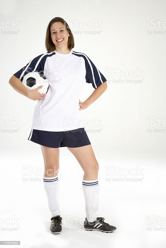 Young Woman Holding a Soccer ball royalty-free stock photo