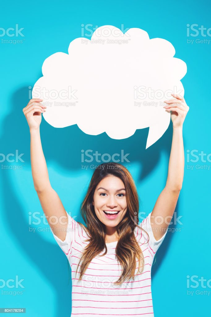 Young woman holding a speech bubble stock photo