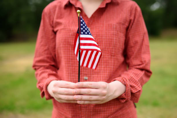 Young woman holding american flag. Independence Day concept. Young woman holding american flag. Independence Day concept. 4th july. green card stock pictures, royalty-free photos & images