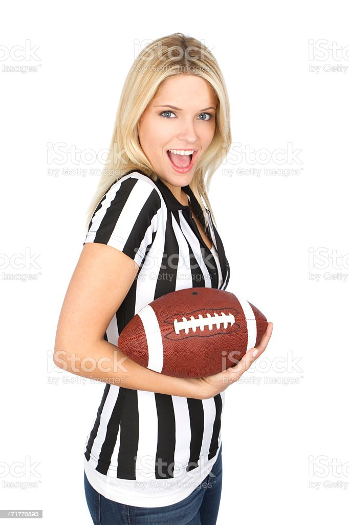 A young woman holding an American football royalty-free stock photo