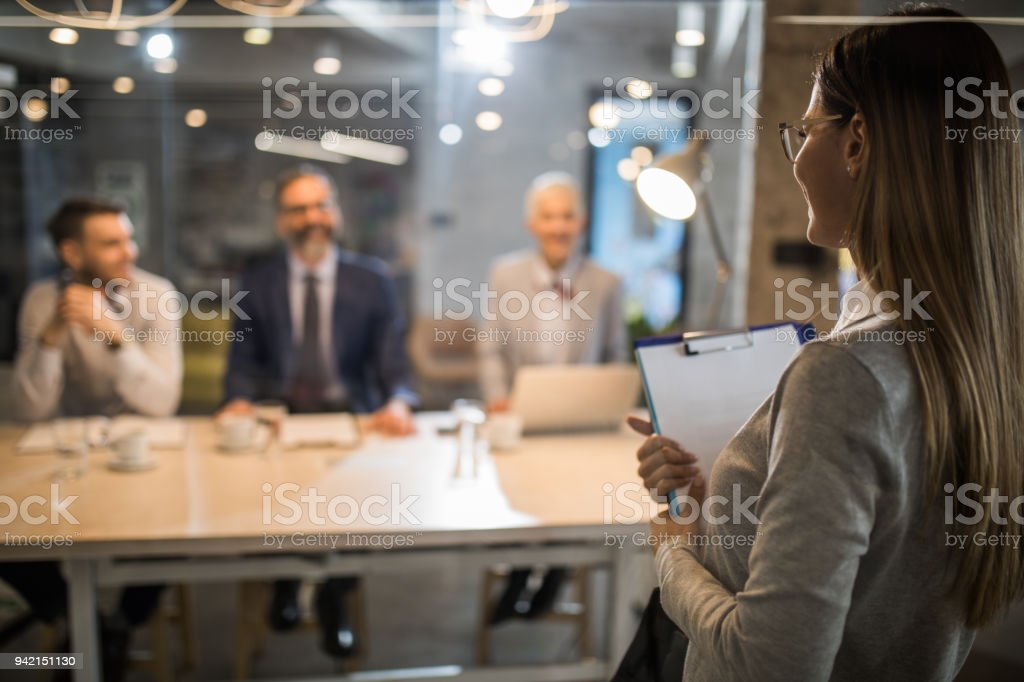 Young woman holding an application form while came to a job interview. stock photo