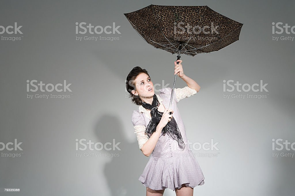 Young woman holding an umbrella stock photo