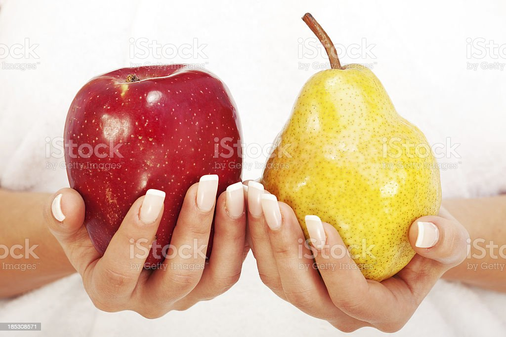 Young woman holding apple and pear stock photo