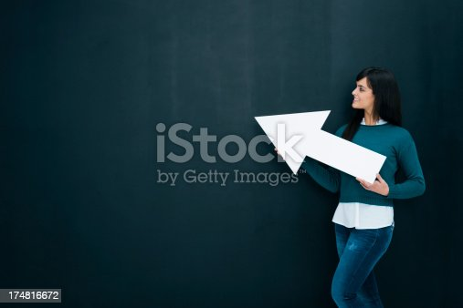 168589045istockphoto Young woman holding arrow 174816672