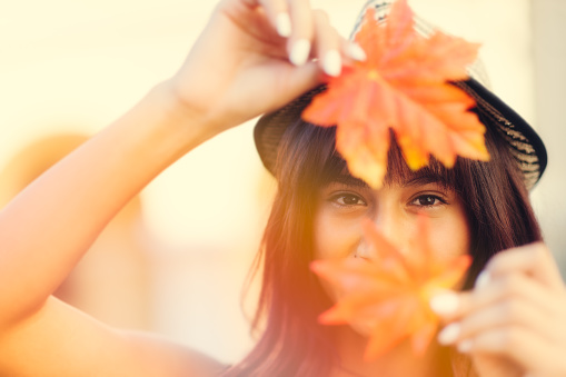 istock Young woman holding Autumn leafs in hands 490851922