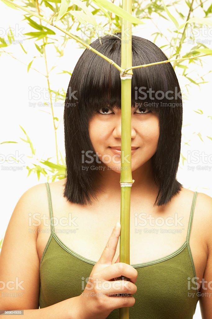 Young Woman Holding Bamboo royalty-free stock photo