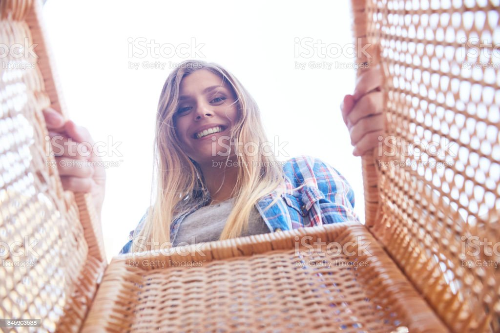 Young Woman Holding Basket stock photo