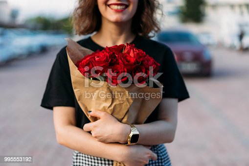 Three bright red Roses isolated on white background.