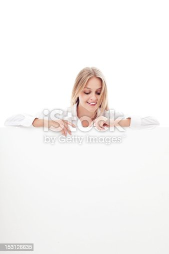 istock Young woman holding billboard 153126635