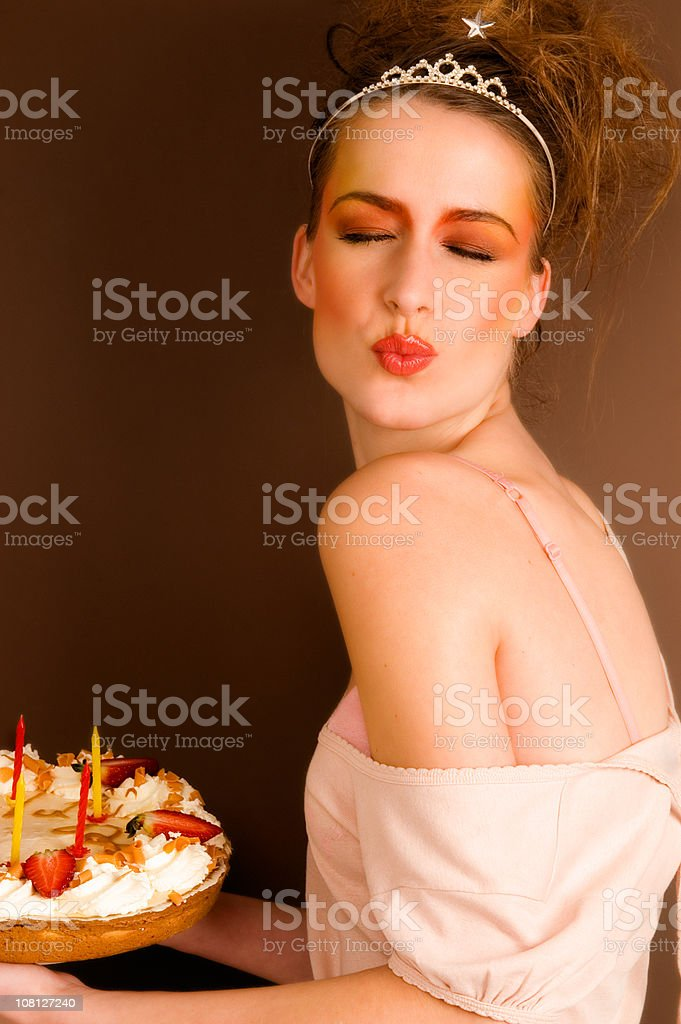 Young Woman Holding Birthday Cake royalty-free stock photo