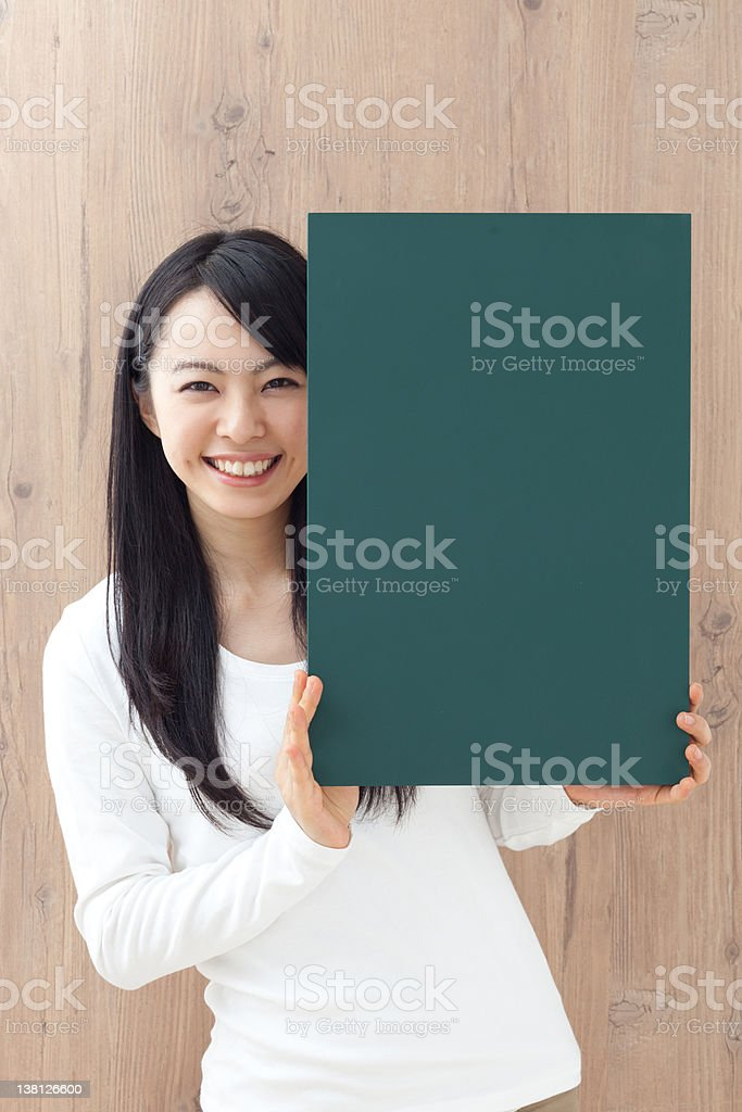 young woman holding blackboard royalty-free stock photo